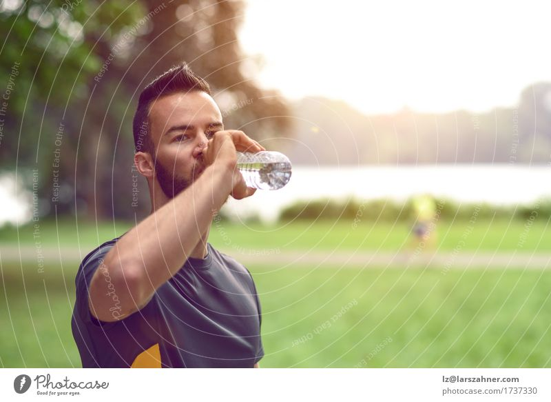 Young man drinking bottled water Human being Youth (Young adults) Man Summer 18 - 30 years Face Adults Warmth Lifestyle Masculine Copy Space Fitness Drinking