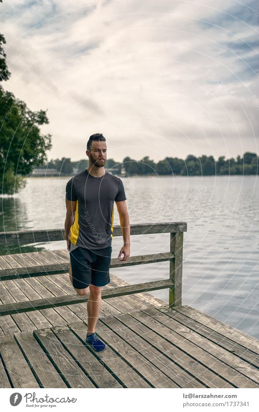 Young man doing stretching exercises Lifestyle Body Face Summer Sports Masculine Man Adults 1 Human being 18 - 30 years Youth (Young adults) Warmth Lake Beard