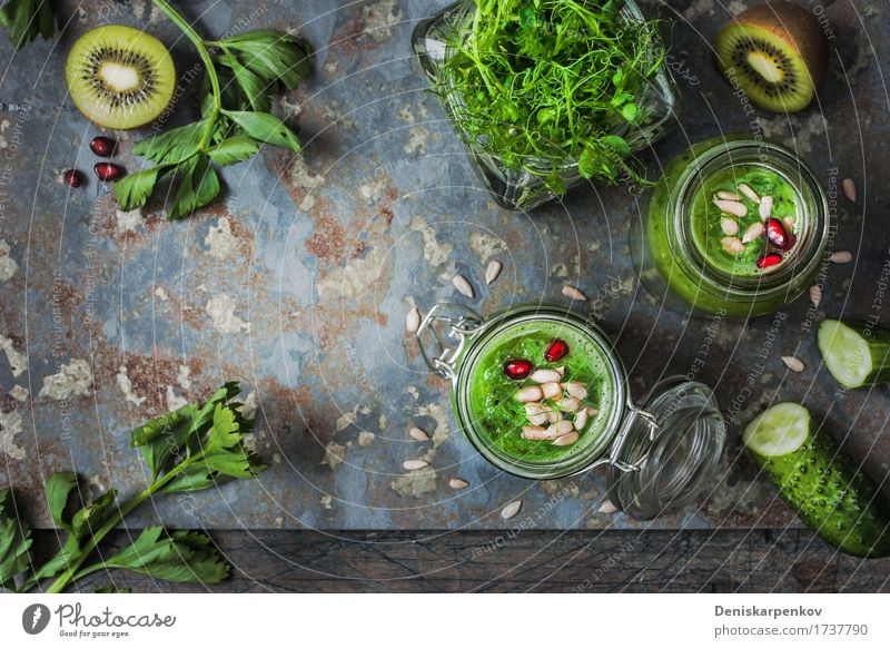 Ingredients for green vegan smoothie with pomegranate Vegetable Fruit Organic produce Vegetarian diet Stone Fresh Bright Green Red Colour board Cereal cooking