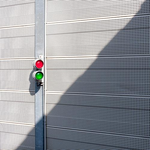 two Wall (barrier) Wall (building) Traffic light Line Simple Green Red Safety Resolve Metal White Bright Colour photo Exterior shot Pattern
