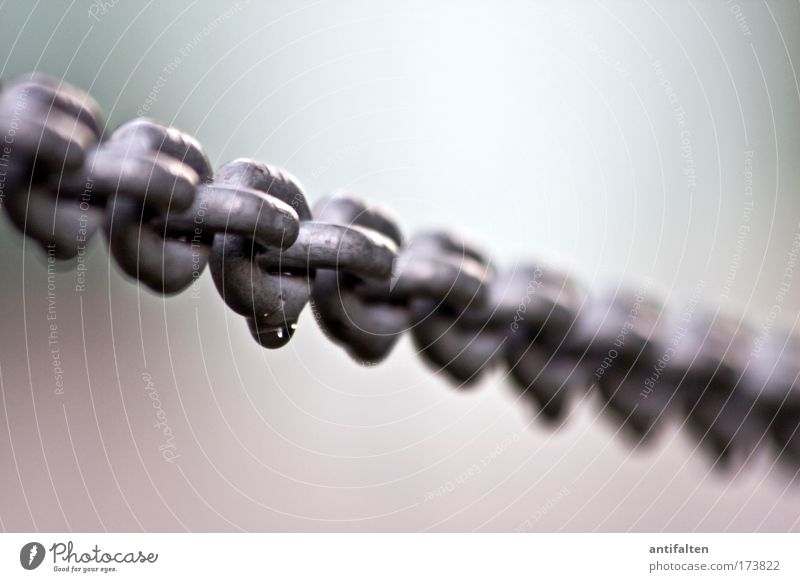 Typical German Drops of water Barrier Metal Steel Chain link Perspective Safety Colour photo Exterior shot Neutral Background Day Sunlight Blur Iron chain