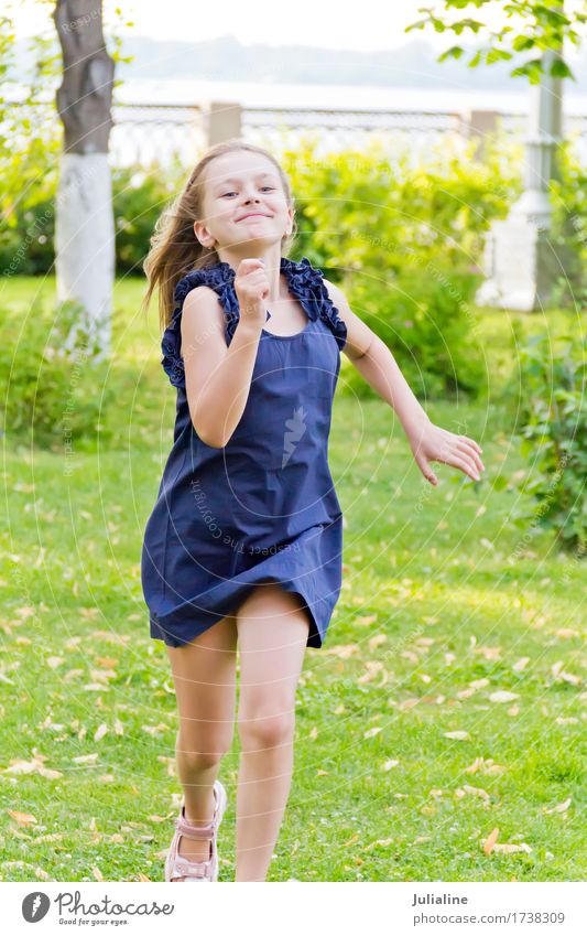 European girl with disheveled hair in green park Woman Child Summer White Girl Adults Lifestyle Playing Park Leisure and hobbies Hair Action Blonde Infancy