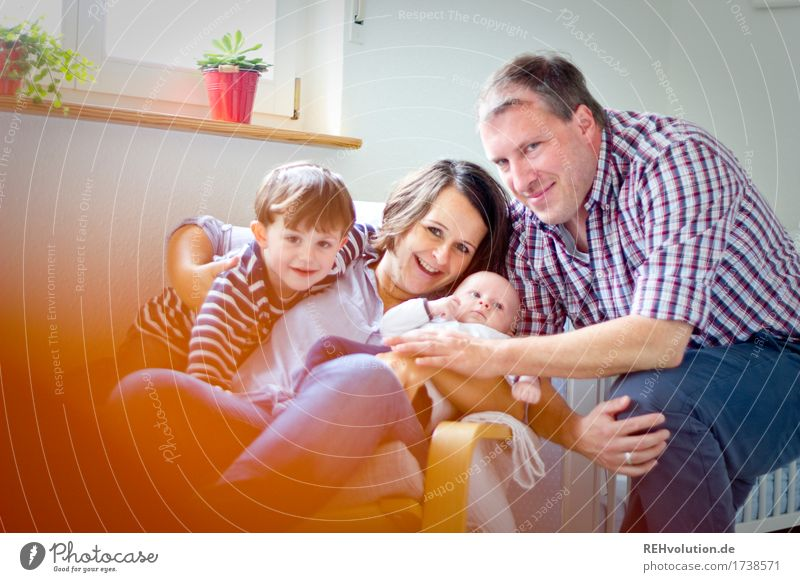 family ties Lifestyle Living or residing Flat (apartment) Living room Human being Child Baby Parents Adults Family & Relations Infancy 4 Smiling Sit Authentic