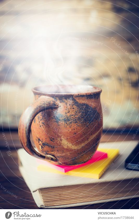 Cup with hot drink on old book Beverage Hot drink Coffee Tea Lifestyle Style Design Living or residing Flat (apartment) Interior design Table Office work Paper