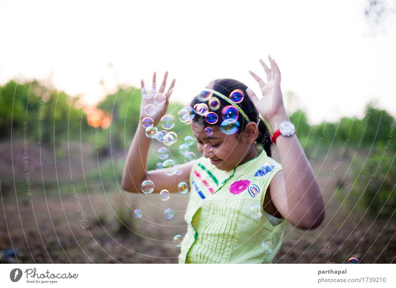 Teenage girl making fun with bubbles Lifestyle Joy Feminine 1 Human being 8 - 13 years Child Infancy Environment Nature Air Sun Smiling Laughter Blue