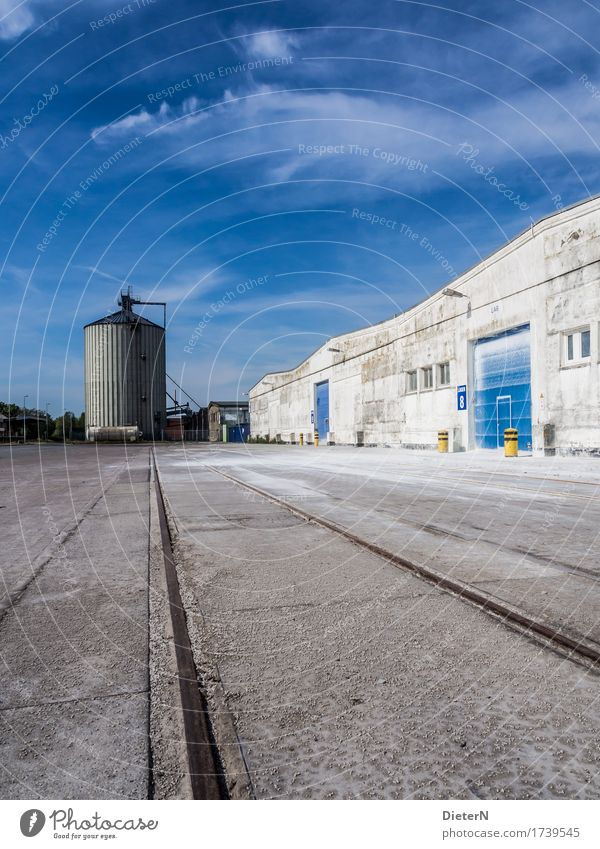 silo Outskirts Deserted Industrial plant Manmade structures Building Architecture Wall (barrier) Wall (building) Facade Blue Black White Silo Railroad tracks