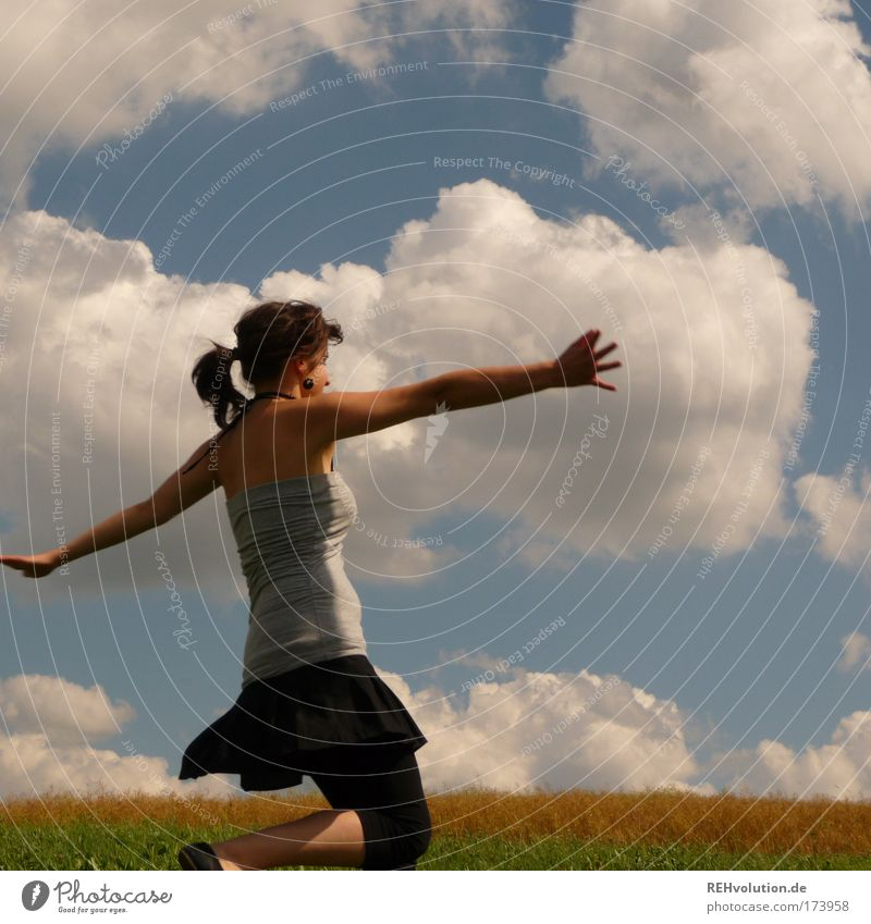 I'm dancing! Colour photo Exterior shot Upper body Feminine Young woman Youth (Young adults) 1 Human being 18 - 30 years Adults Sky Clouds Meadow Skirt Braids