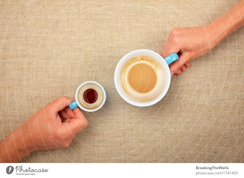 Two hands holding empty coffee cupsof espresso latte cappuccino Woman Man White Hand Adults Small Together Vantage point Beverage Coffee To hold on Hot Top Hold