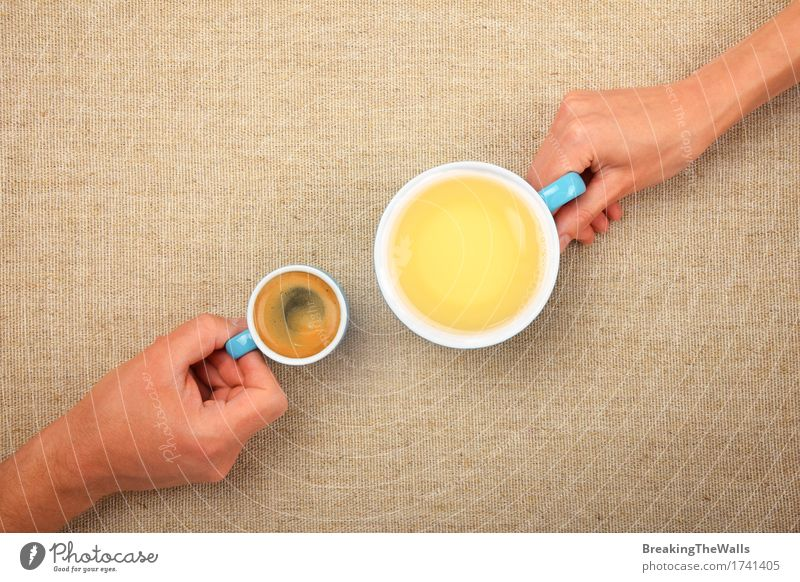 Two hands holding full cups of coffee and green tea Woman Man Blue Green Hand Adults Small Together Vantage point Warm-heartedness Romance Beverage Coffee