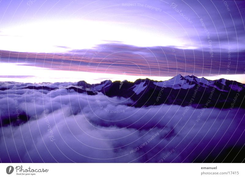 Mountains in the light Light Clouds Natural phenomenon