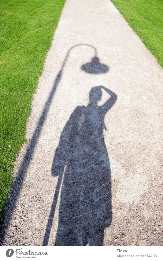 Hats off! Colour photo Exterior shot Day Light Shadow Contrast Silhouette 1 Human being Green Absurdity Joy Funny Lantern Lawn Sandy path Sidewalk Park