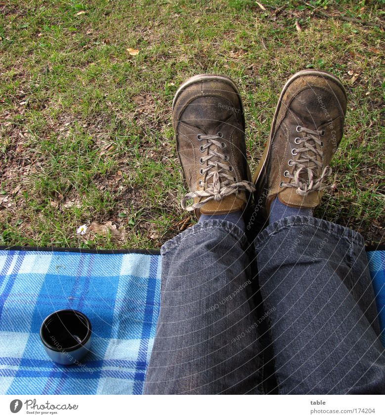 picnic Colour photo Nutrition Beverage Hot drink Coffee Mug Lifestyle Joy Leisure and hobbies Trip Man Adults Legs Feet Grass Meadow Jeans Footwear Relaxation