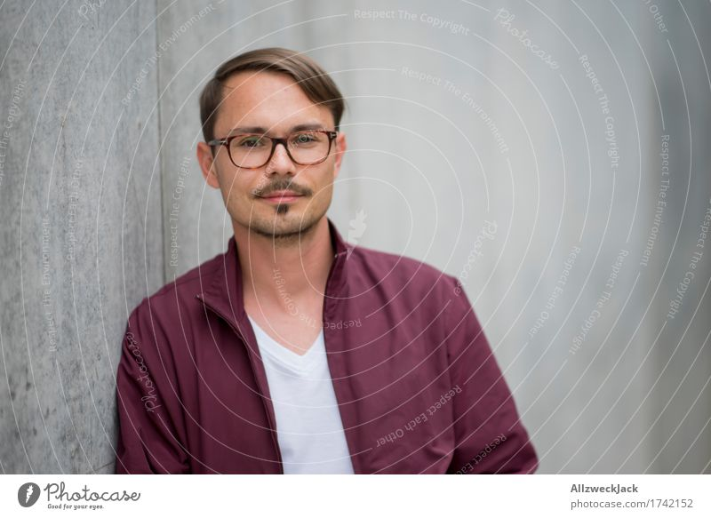 Portrait 1 Masculine Young man Youth (Young adults) Man Adults Human being 18 - 30 years 30 - 45 years Jacket Eyeglasses Brunette Part Moustache Friendliness