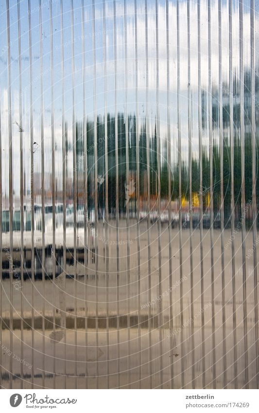 review Glass Ribbed glass Transparent transparency Places Parking lot Parking area porch Window Car Tree Sky Clouds abstraction Unclear Copy Space
