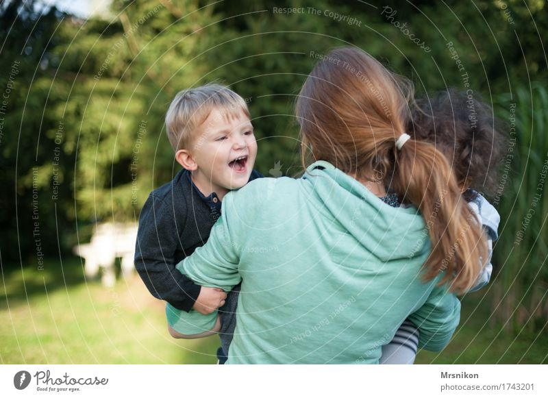 Human being Child Youth (Young adults) Summer Joy 18 - 30 years Adults Life Boy (child) Family & Relations Playing Laughter Happy Garden Together Illuminate