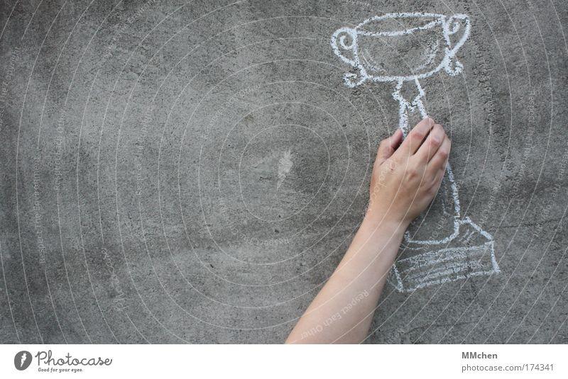 reward Cup (trophy) Chalk Concrete Wall (building) imagination Deception Hand Fingers Success Feasts & Celebrations endgame Sports Sporting event Championship