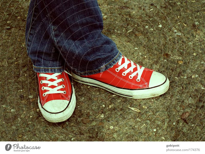 stand Youth (Young adults) Legs Feet 1 Human being Youth culture Fashion Clothing Jeans Sneakers Stand Wait Cold Gloomy Blue Red Nerviness Fear Lifeless Stress