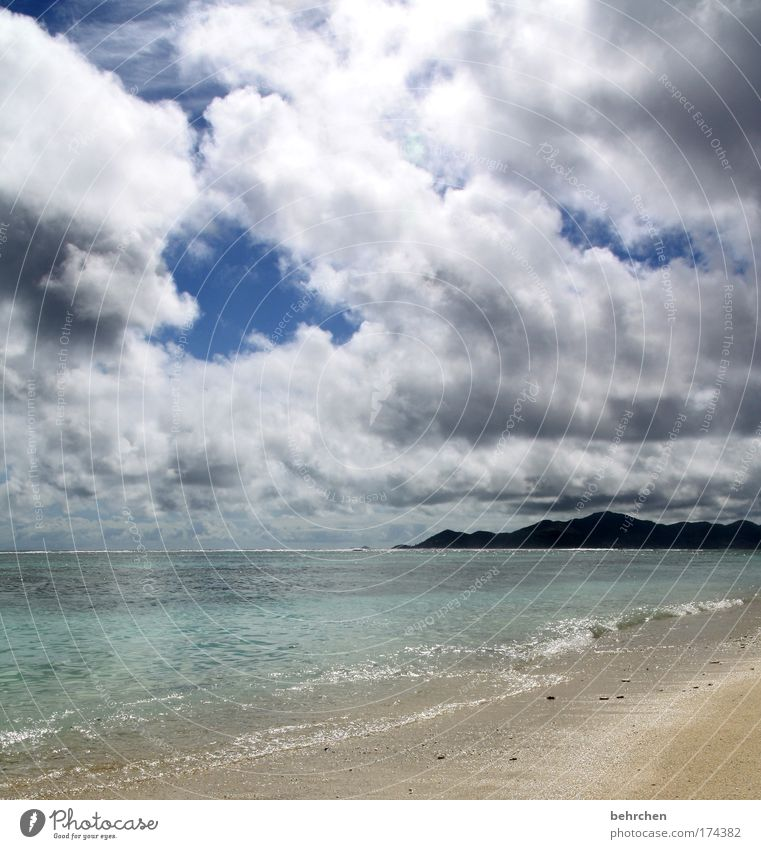 Sky Beach Vacation & Travel Ocean Clouds Far-off places Freedom Mountain Dream Coast Rain Waves Contentment Wet Island Tourism