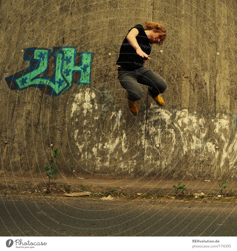 Young man jumps Colour photo Exterior shot Full-length Style Joy Human being Masculine Youth (Young adults) 1 18 - 30 years Adults Wall (barrier)