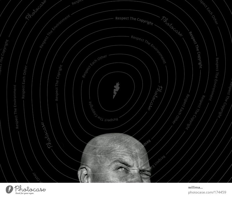 sceptical looking bald man in front of black background Man Adults Head Bald or shaved head Black Concern Fear Fear of the future Stress Disbelief Jealousy