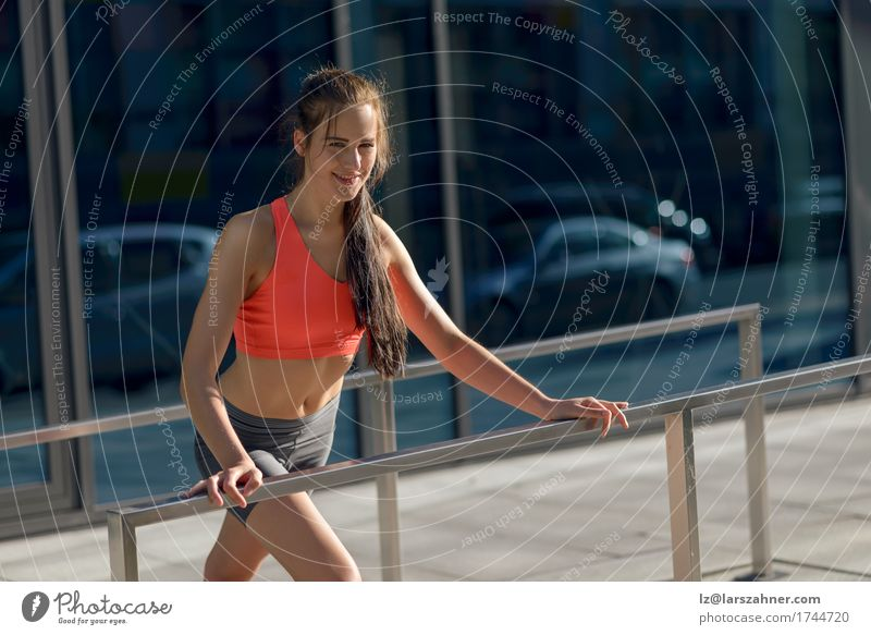 Fit young woman doing stretching exercises Human being Woman Youth (Young adults) Summer 18 - 30 years Adults Sports Lifestyle Feminine Happy Action Smiling