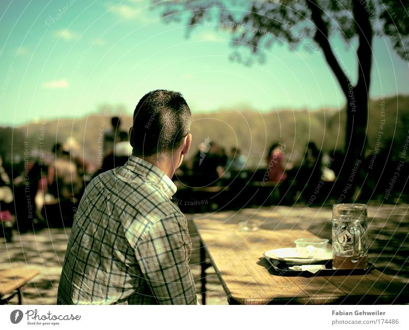 watching the last supper Colour photo Exterior shot Day Shallow depth of field Rear view Looking away Beer Crockery Leisure and hobbies Human being Masculine