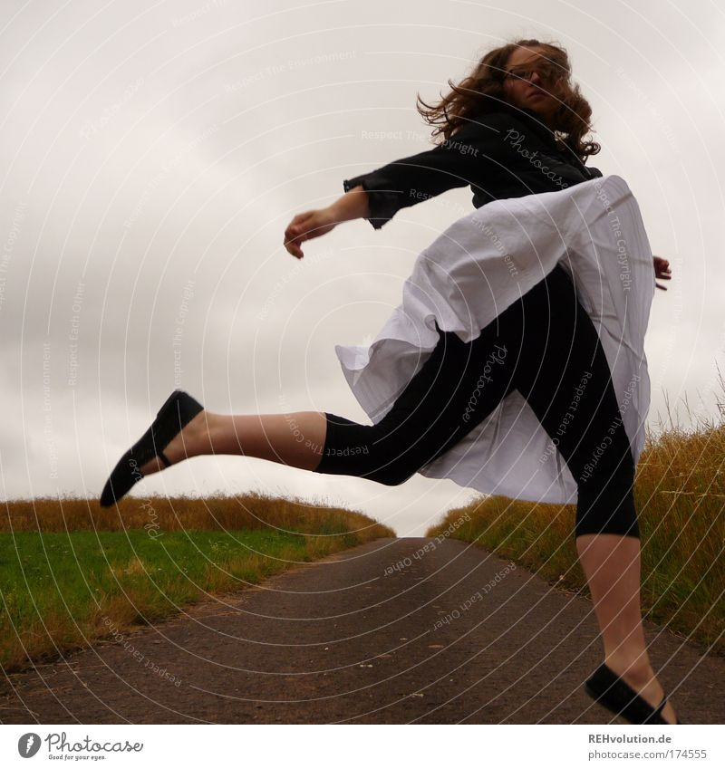 Woman jumps in a street Colour photo Exterior shot Full-length Joy Human being Feminine Young woman Youth (Young adults) 1 18 - 30 years Adults Landscape Meadow