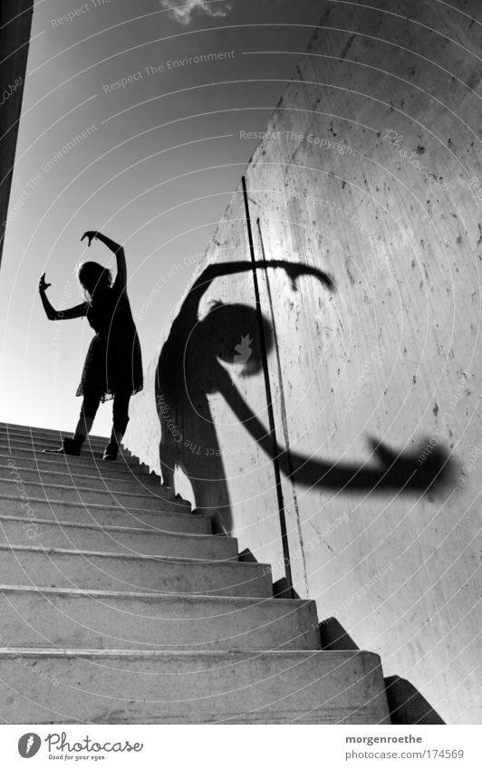 Human being Youth (Young adults) Beautiful Sky White Black Feminine Wall (building) Playing Art Adults Arm Stairs Action Leisure and hobbies Image