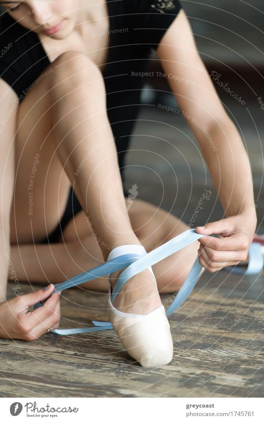 Girl with long legs tying her ballet shoes on the floor Elegant Beautiful Academic studies Human being 1 13 - 18 years Youth (Young adults) Dancer Ballet Tie