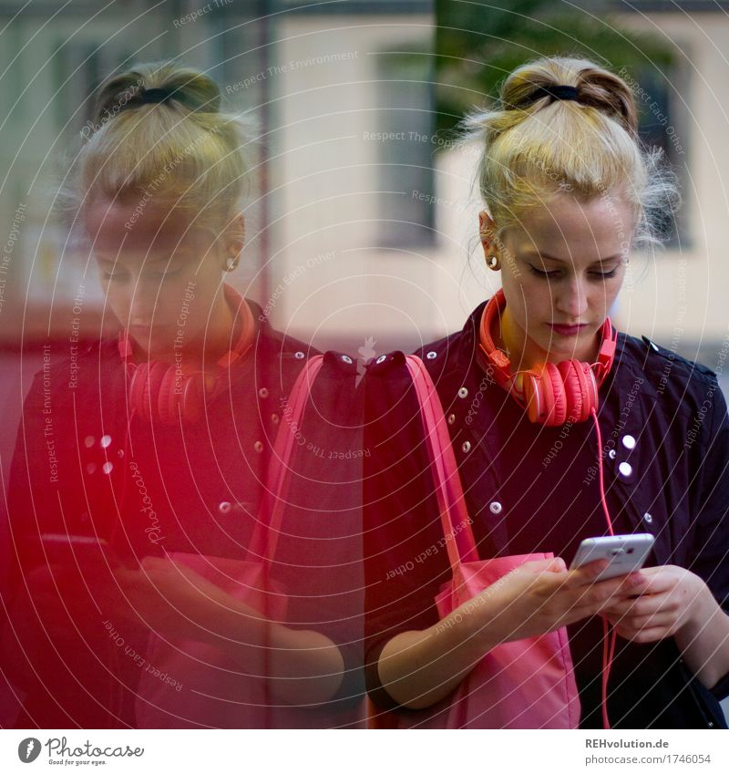 Alexa   Young woman standing in the city with smartphone Human being Youth (Young adults) 1 18 - 30 years Adults Culture Youth culture Subculture Music