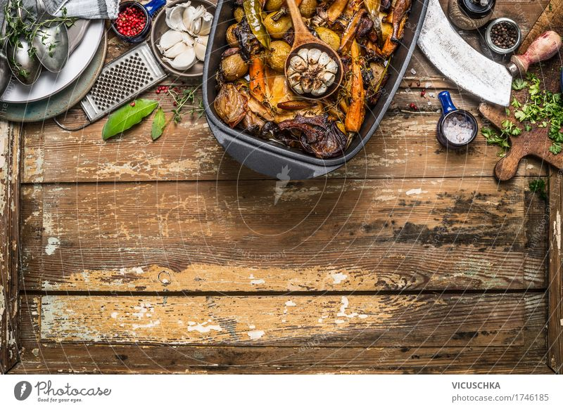 Roasted vegetable stew and kitchen utensils Food Meat Vegetable Soup Stew Herbs and spices Cooking oil Nutrition Lunch Buffet Brunch Banquet Slow food Crockery