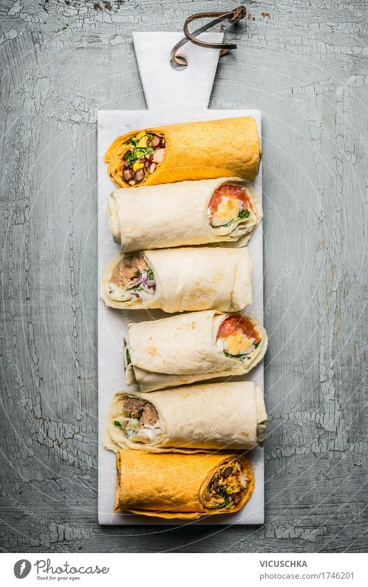 Various vegetarian tortilla wraps Food Fish Seafood Vegetable Lettuce Salad Bread Nutrition Lunch Banquet Organic produce Vegetarian diet Style Healthy Eating