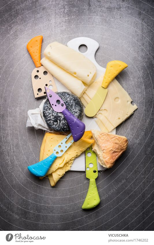 cheese platter Food Cheese Dairy Products Nutrition Knives Style Design Yellow Chopping board Food photograph Eating Cheese knife Selection Cheese slice