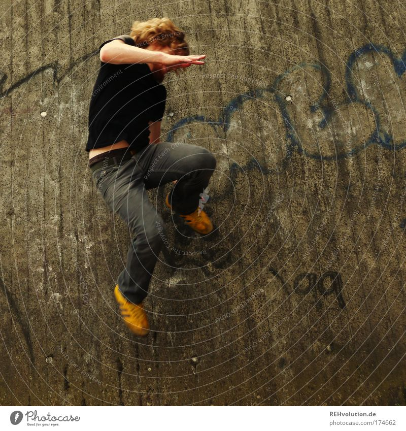 Human being Youth (Young adults) Adults Yellow Wall (building) Freedom Gray Movement Happy Jump Wall (barrier) Style Healthy Power Leisure and hobbies Masculine
