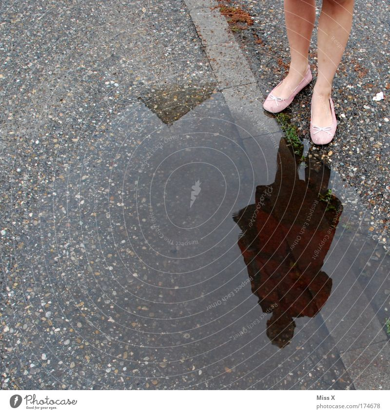 Human being Water Street Autumn Feminine Lanes & trails Feet Legs Weather Wet Skirt Sidewalk Puddle Mirror image Rainwater Bad weather
