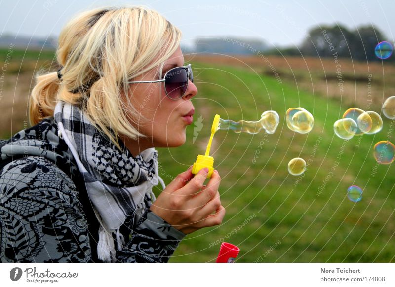 * Soap bubbles* Colour photo Multicoloured Exterior shot Neutral Background Day Shallow depth of field Central perspective Upper body Profile Looking away Joy