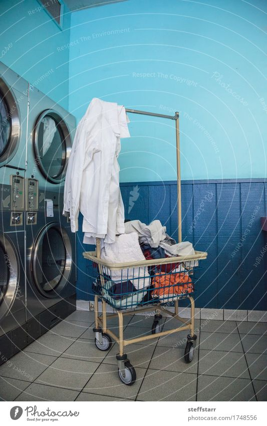 Washing clothes and drying at the Laundromat Machinery Industry Clothing T-shirt Shirt Skirt Pants Underwear Cleaning Blue Turquoise White Colour photo