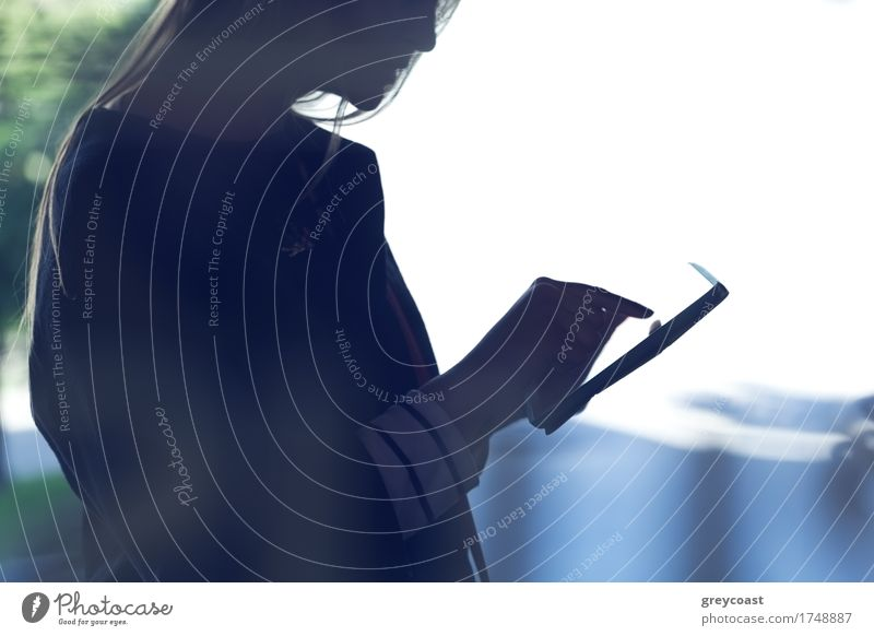 Silhouette of a woman using touchpad. Shot on bright light background Computer Technology Human being Girl Young woman Youth (Young adults) 1 18 - 30 years