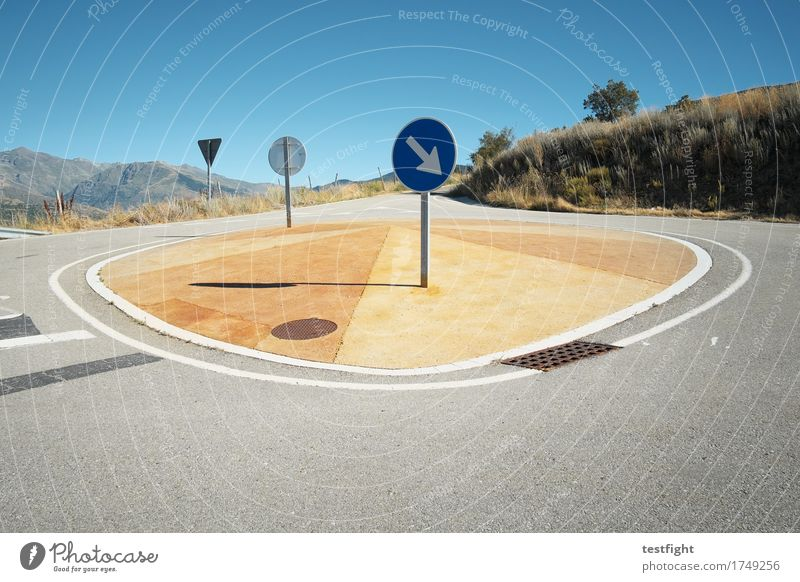 island Environment Nature Landscape Mountain Transport Traffic infrastructure Street Driving Blue Road sign Street refuge Traffic circle Pavement Colour photo