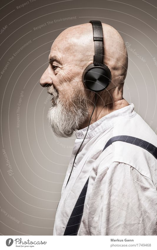 Human being Black Senior citizen Lifestyle Style Masculine Music Cool (slang) Facial hair Listening Headphones Bald or shaved head Beige Sound Song