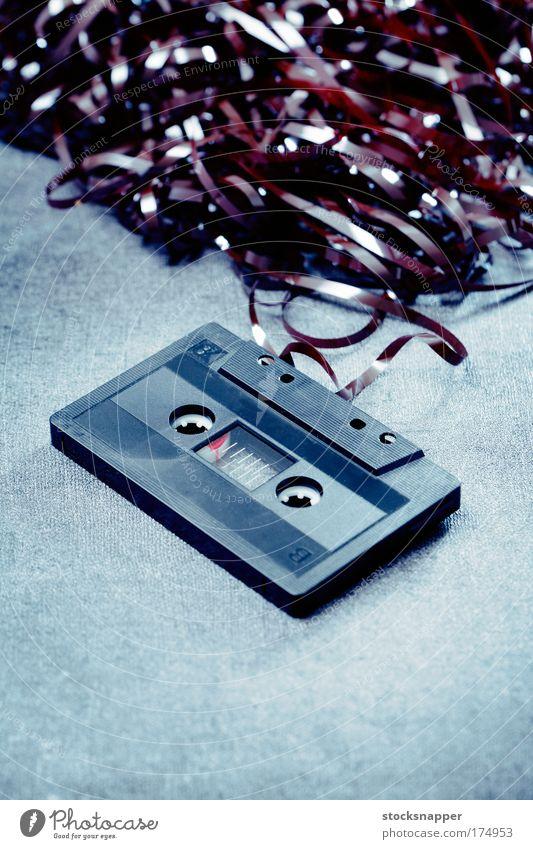 Old audio Tape cassette c-cassette c cassette Sound tangle tangled Black obsolete Trash junk Broken Heap Object photography