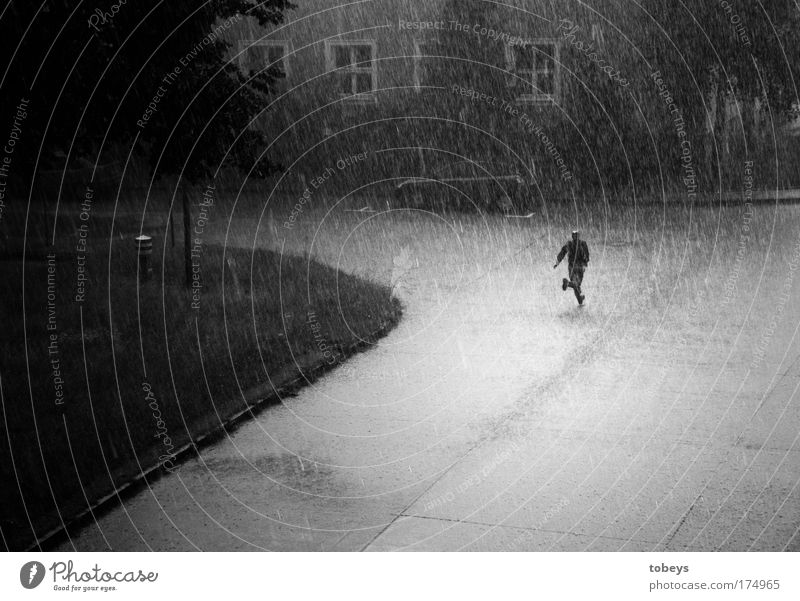 the curse Human being Masculine Walking Running Rain Thunder and lightning Gale Hail Loneliness Wet Damp Cold Escape Dry Black & white photo Exterior shot