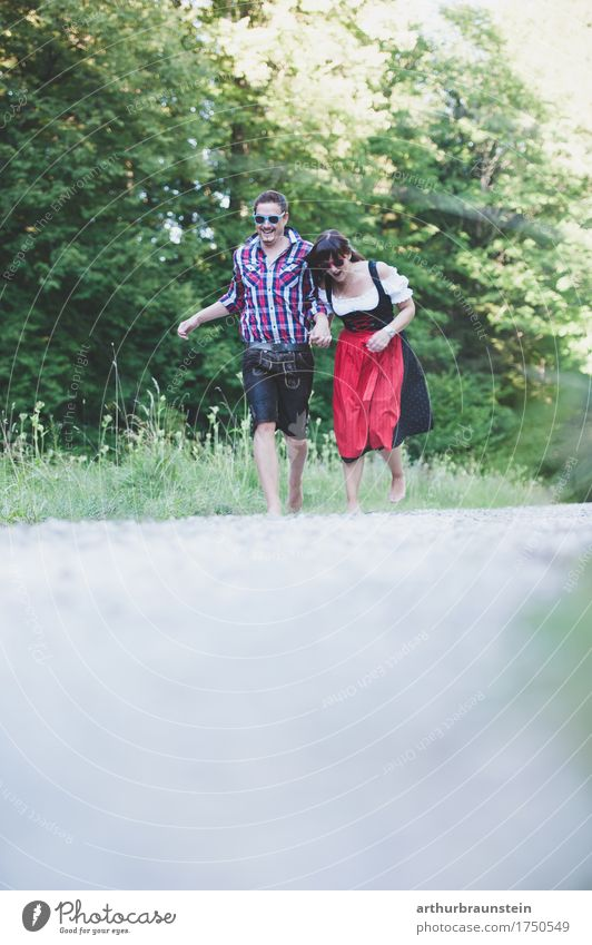 Young couple walking barefoot in traditional costume Lifestyle Vacation & Travel Tourism Trip Summer Summer vacation Hiking To go for a walk Human being