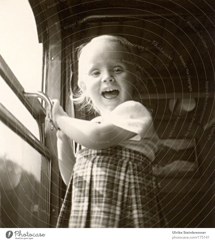 Little laughing girl standing at the open train window Black & white photo Interior shot Day Upper body Looking into the camera Human being Child 1 3 - 8 years