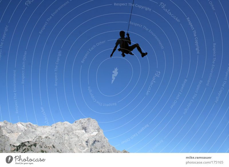 Spider against blue 1 Colour photo Exterior shot Day Silhouette Climbing Adventure Mountain Sports Mountaineering Human being Landscape Cloudless sky Rock Alps