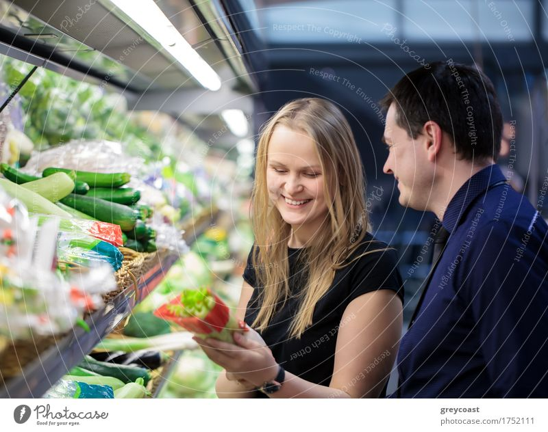Man and woman shopping for vegetables Human being Woman Man Girl Adults Family & Relations Happy Couple Friendship Smiling Shopping Vegetable Storage Checkered Horizontal Supermarket