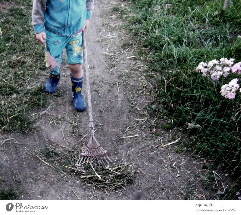 - - - - - - - Colour photo Exterior shot Copy Space right Child Boy (child) 1 Human being 3 - 8 years Infancy Workwear Pants Rubber boots Dirty Checkmark Going
