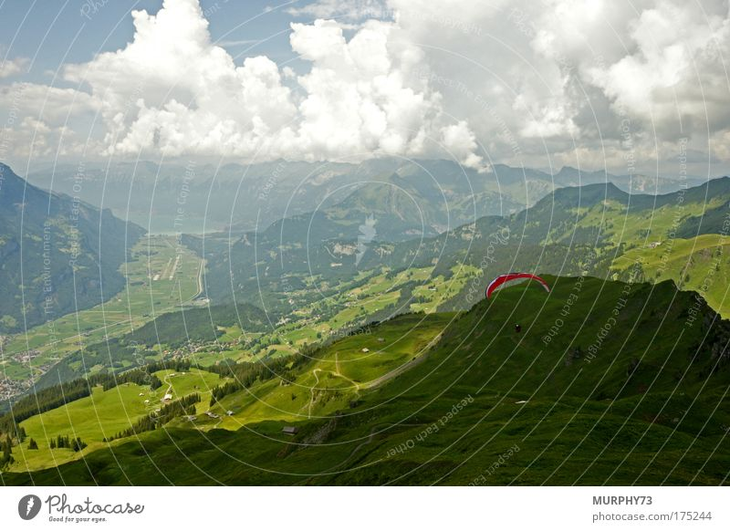 Paragliding jump in the Bernese Oberland Colour photo Exterior shot Day Deep depth of field Bird's-eye view Wide angle Vacation & Travel Tourism Trip Freedom