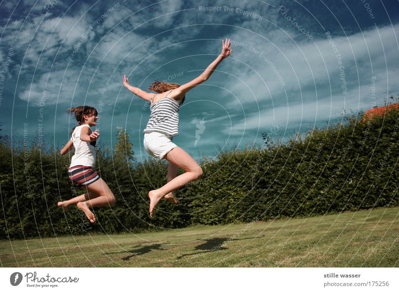 Human being Child Sky Youth (Young adults) Sun Summer Girl Joy Clouds Woman Life Meadow Feminine Playing Freedom Movement