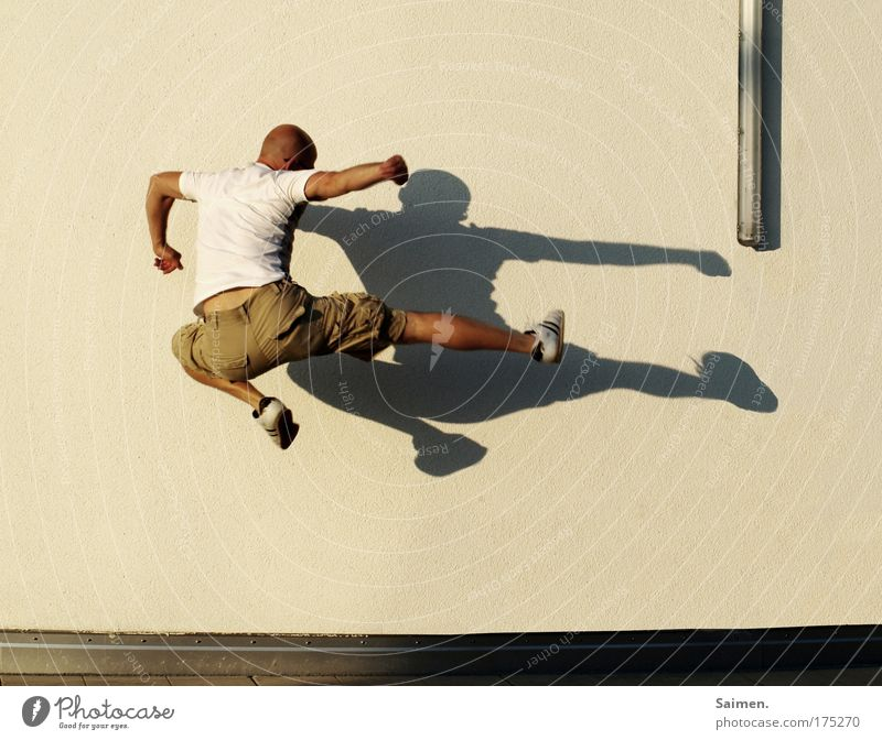 everybody was kungfu-fighting Colour photo Subdued colour Exterior shot Copy Space bottom Shadow Sunlight Sunrise Sunset Full-length Sports Sportsperson